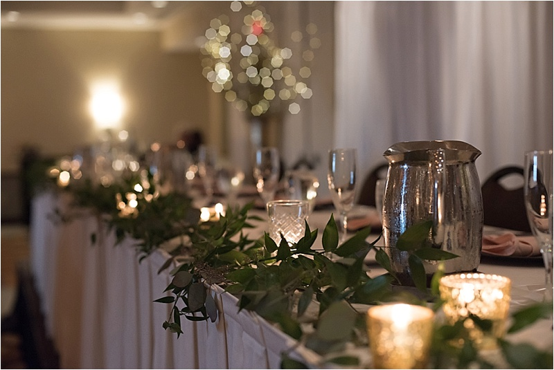formal wedding reception with eucalyptus vines