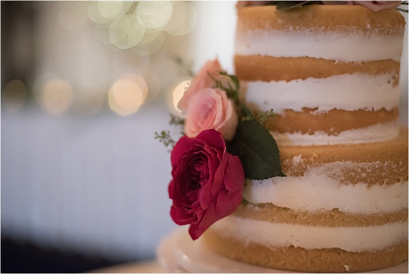 blush rose accent on unfrosted wedding cake