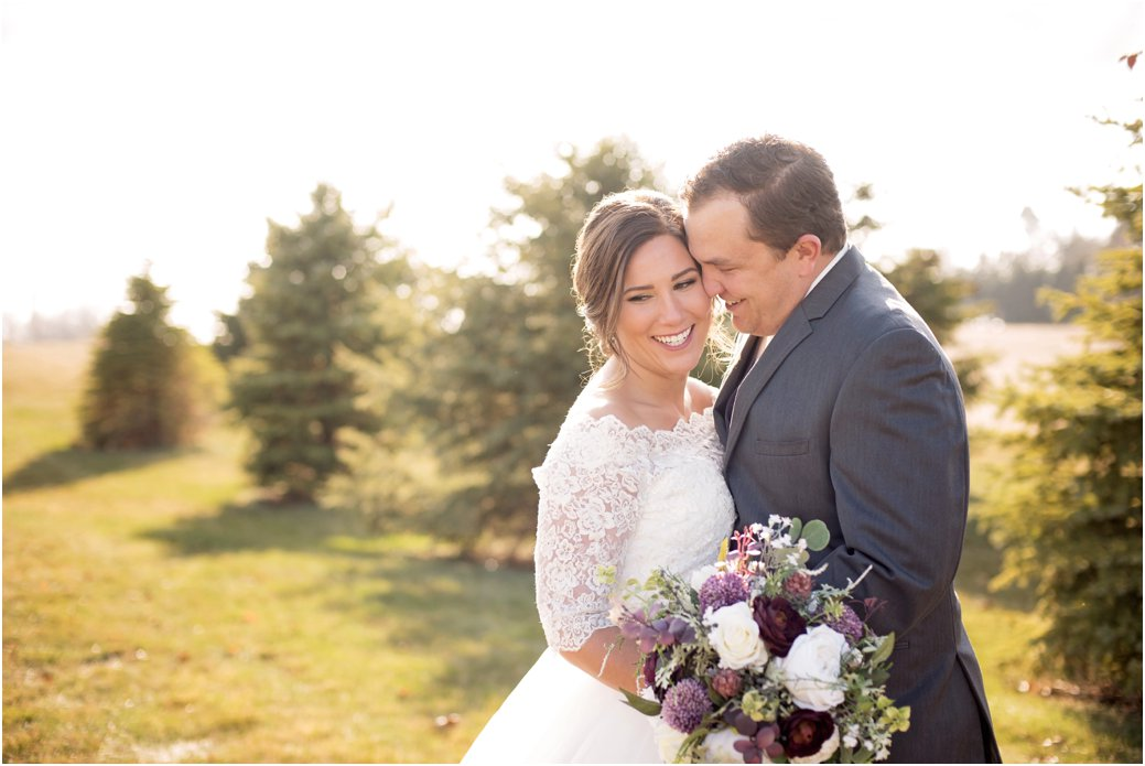 gray groom suit and lace wedding gown