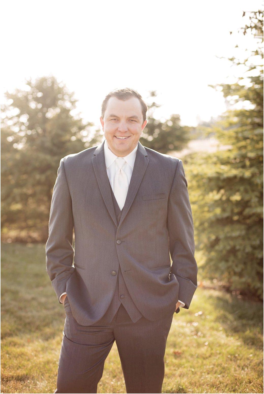 groom in three piece gray suit