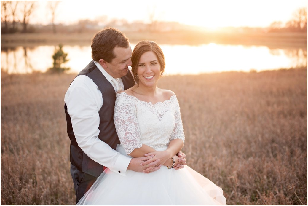 artistic portraits after wedding ceremony in a field