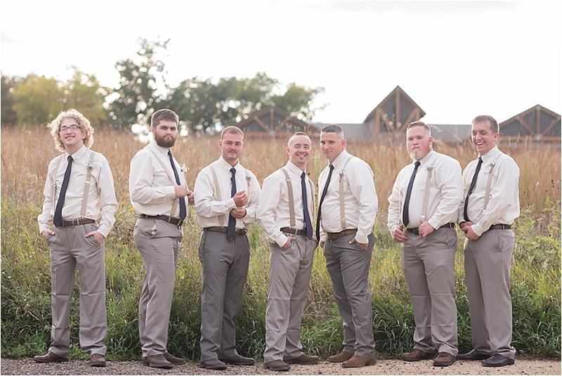 ivory and plum with khaki suspenders groomsmen suits