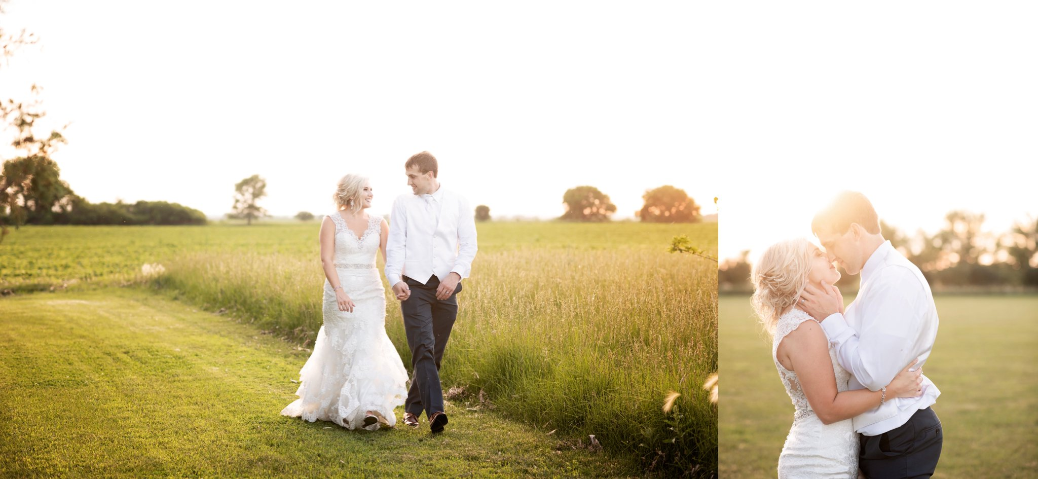 bride and groom walk through field together holding hands