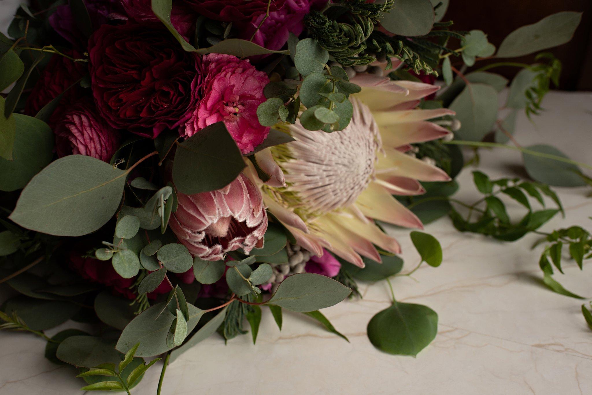 exotic boho wedding bouquet with fuchsia