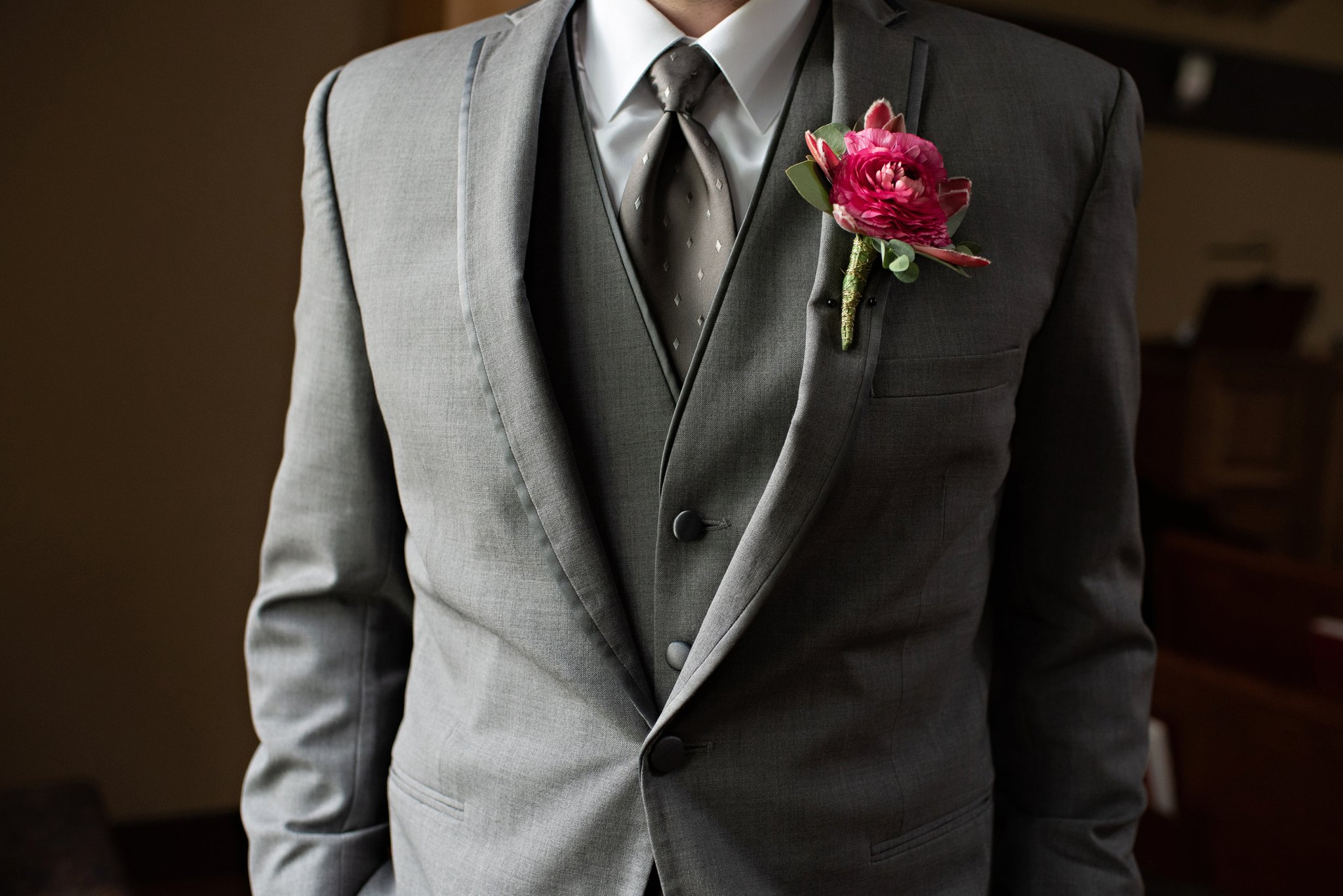 charcoal gray three piece suit