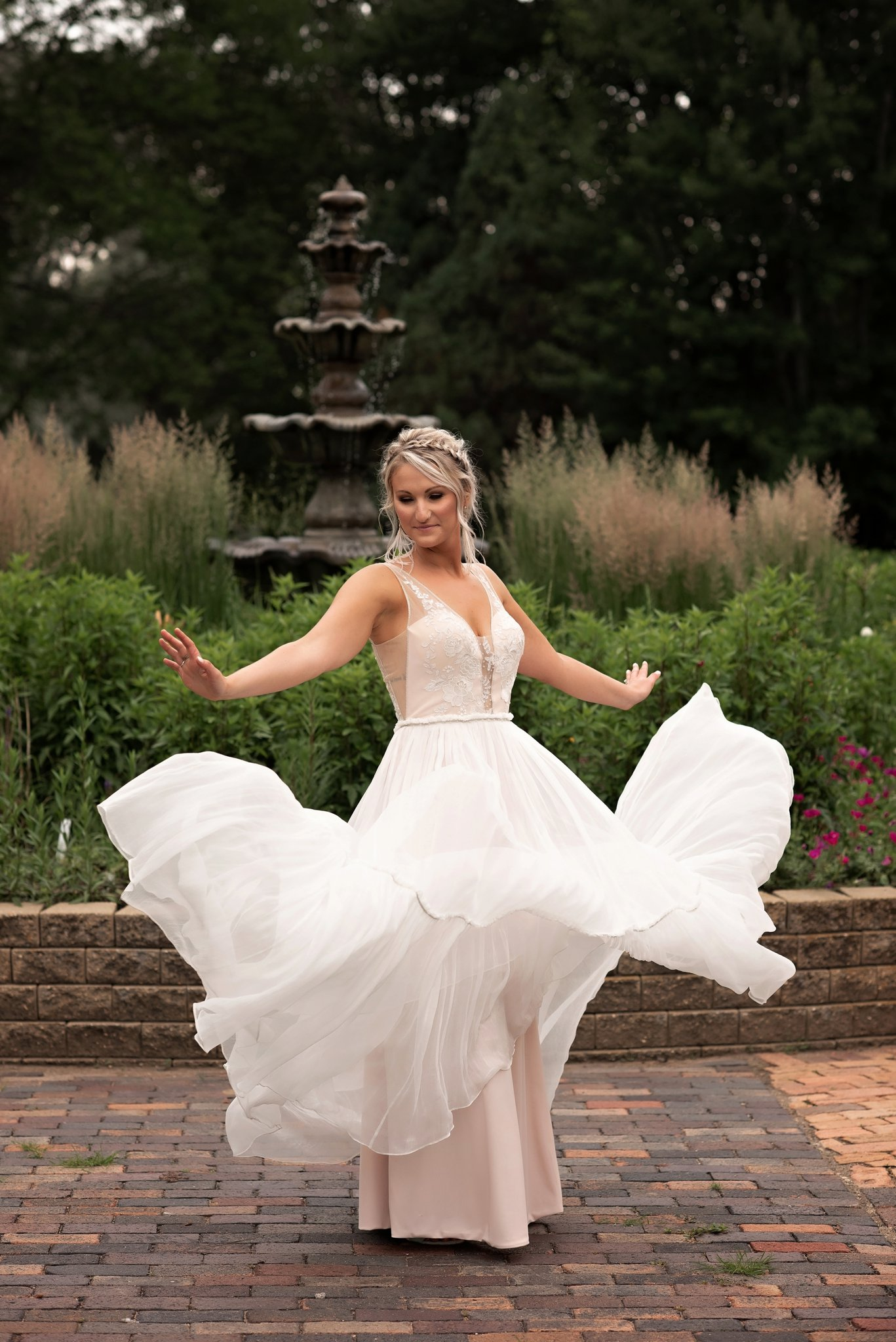 brides flowy dress spins in the air
