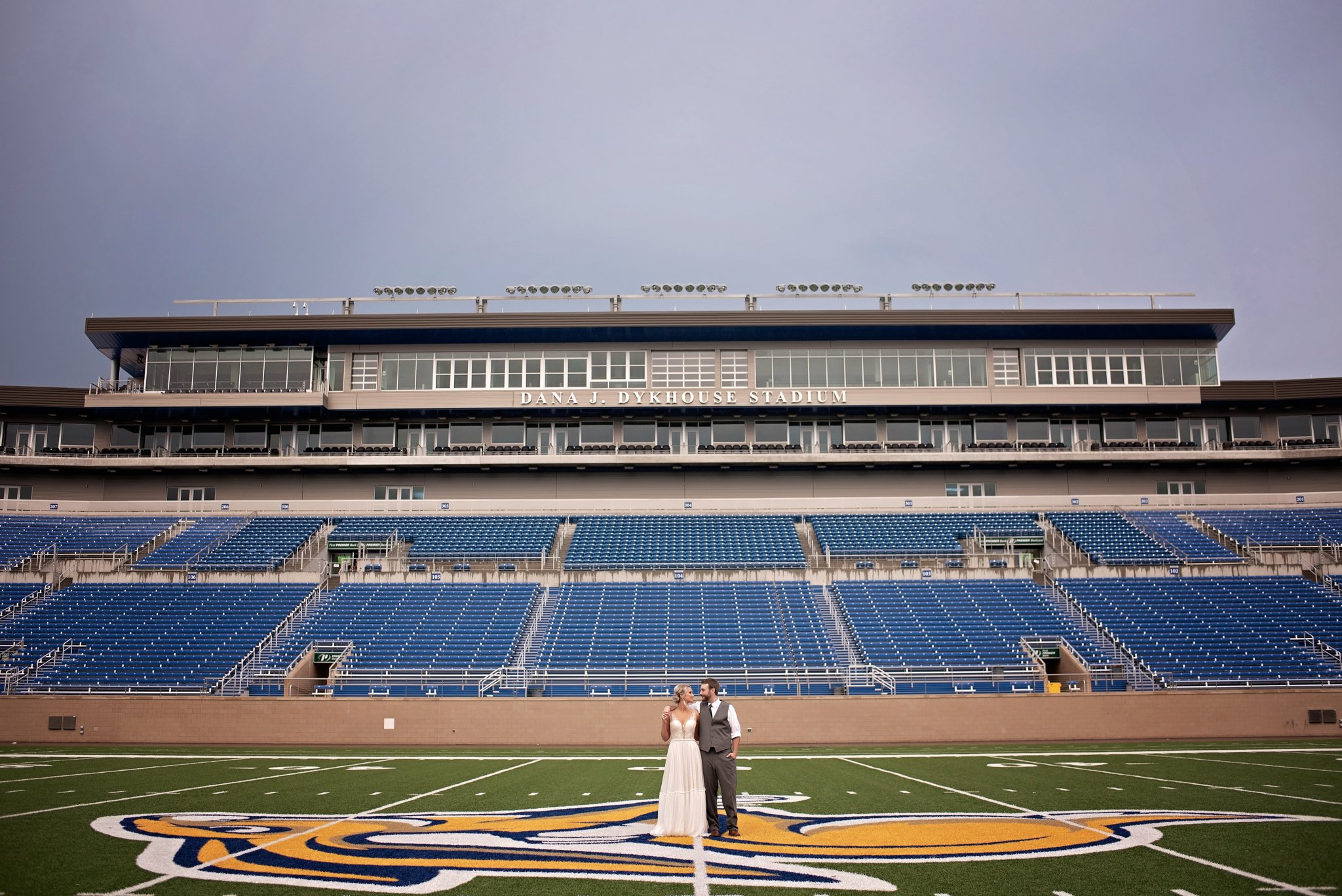 bride and groom in Dana Dykehouse stadium
