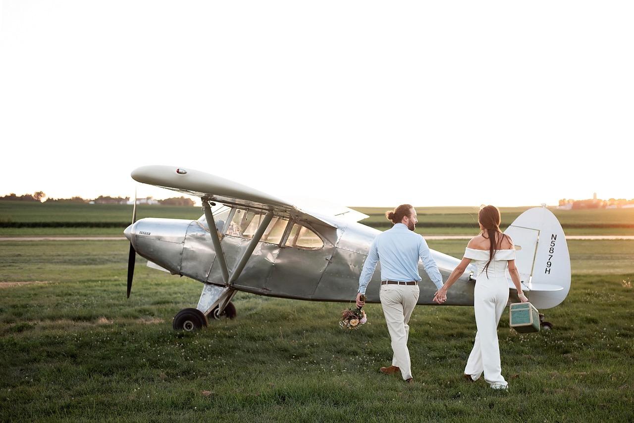 bride and groom getaway in vintage piper airplane