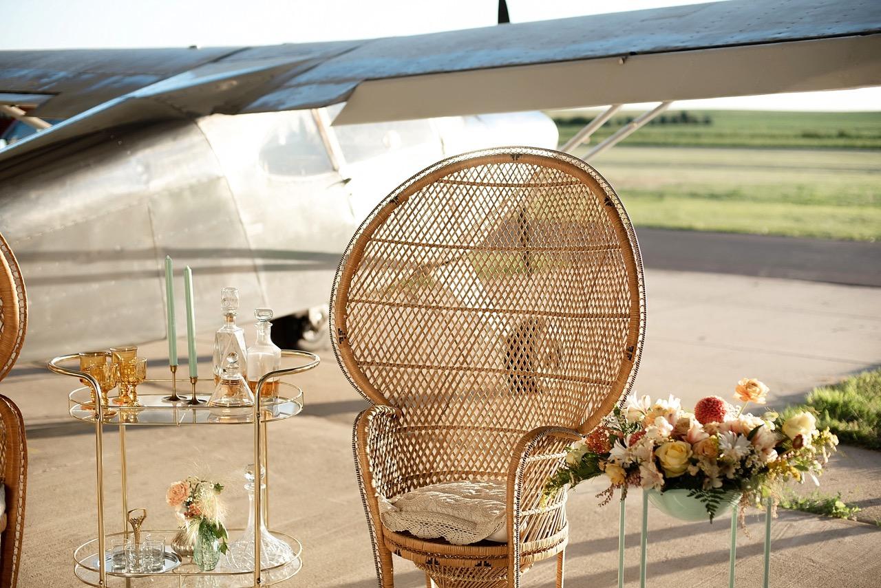 peacock chair at airplane vintage wedding shoot