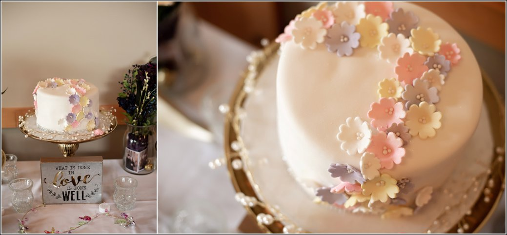 white fondant one layer cake with fondant florals