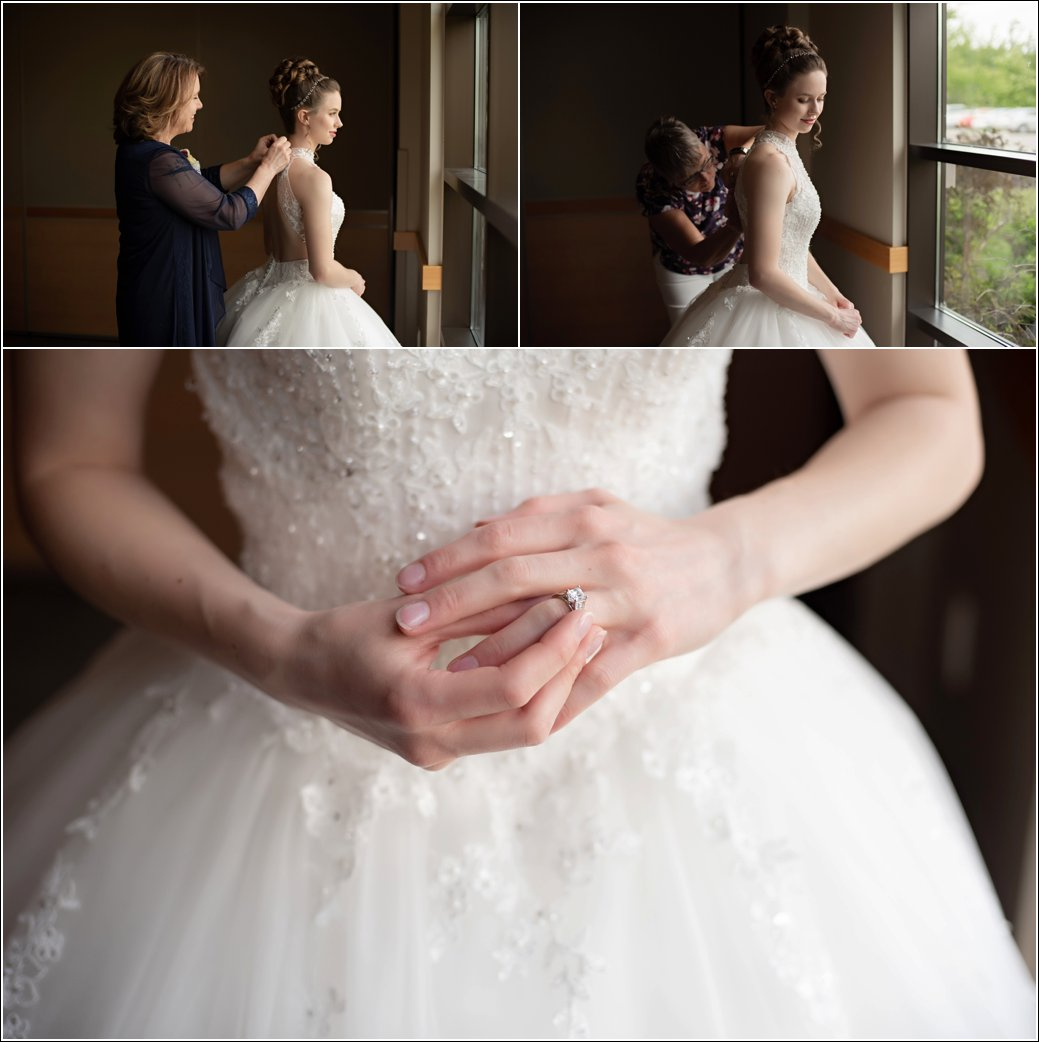 bride gets dressed in beaded ballgown