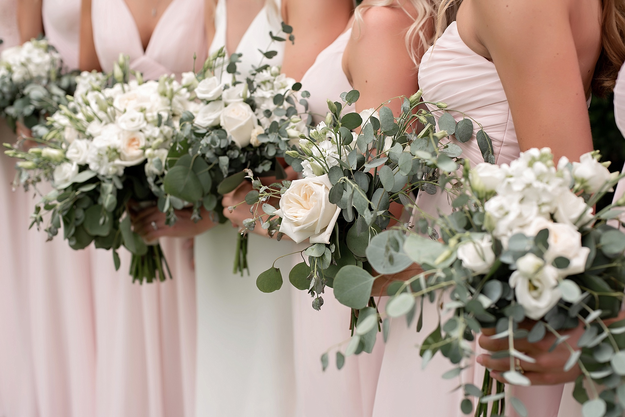 blush bridesmaid dresses with white florals