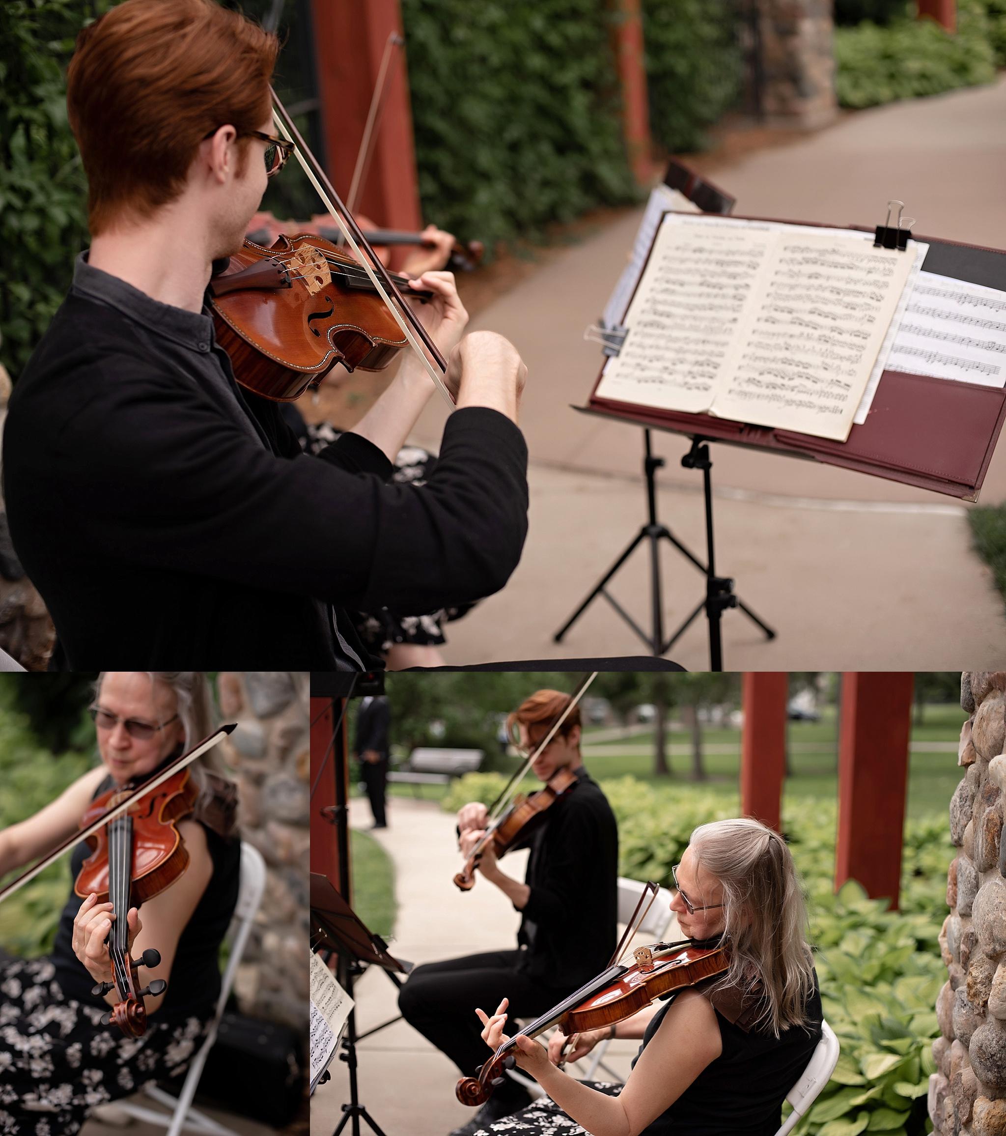 duet plays violin viola at wedding ceremony garden park wedding
