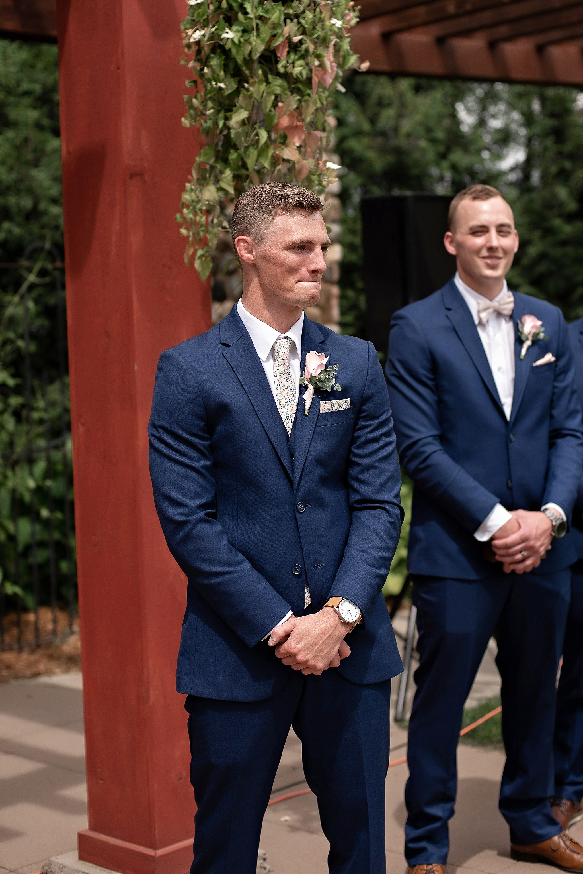 groom shows emotion as bride walks down the aisle