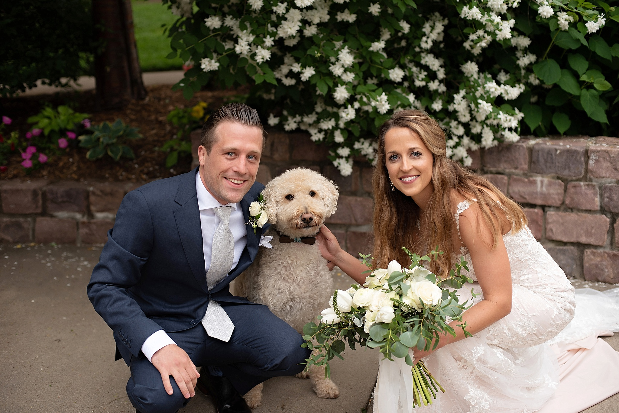 bride and groom with their best puppy