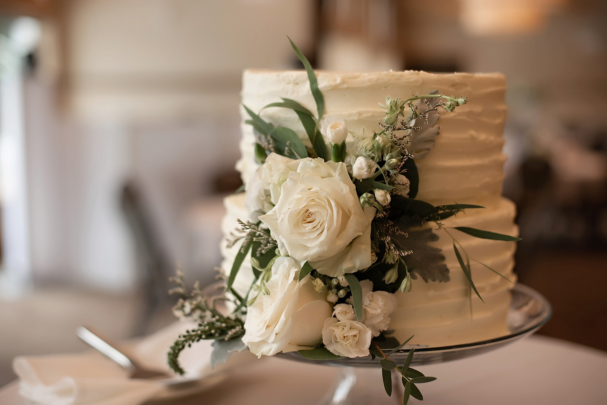 white textured cake with white florals the country club of sioux falls