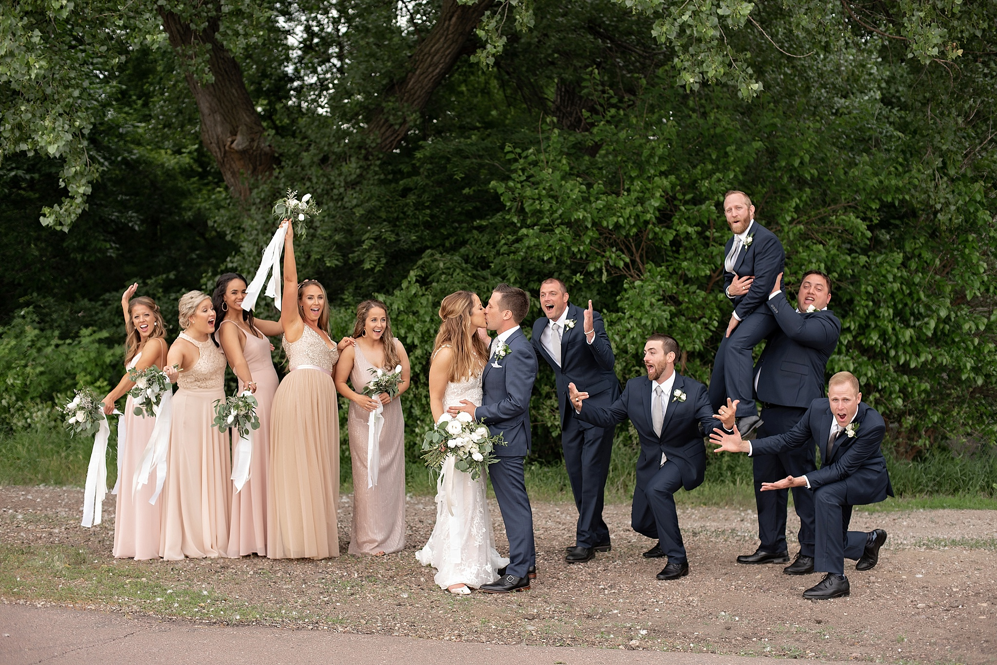 blush white and navy wedding party celebrate the couple