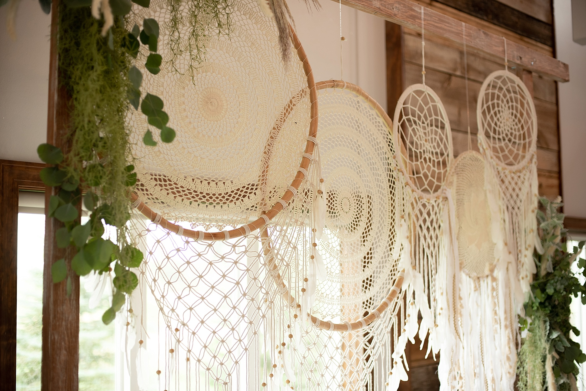 boho dream catchers on wedding arch