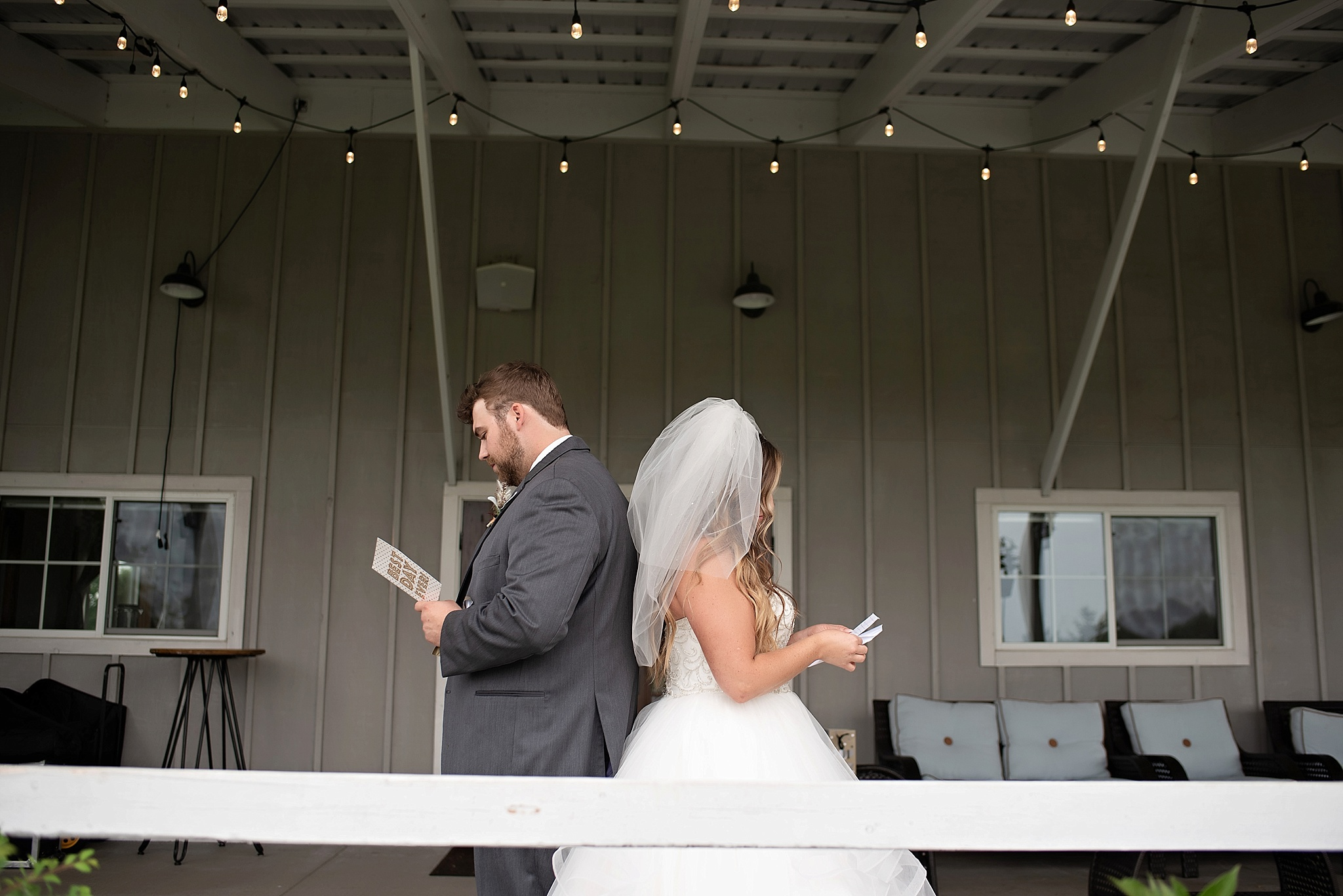 bride and groom read letters to each other back to back