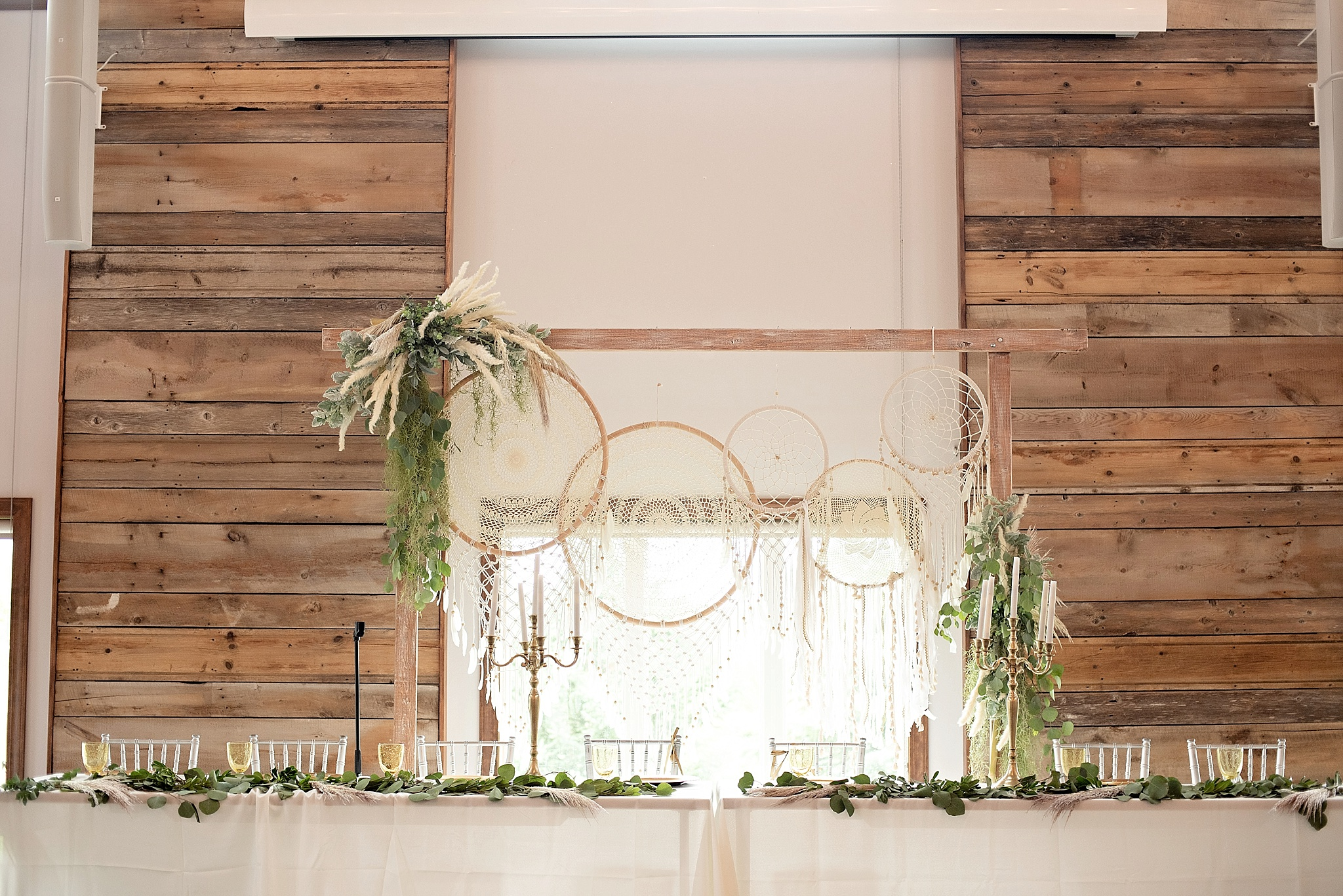 boho dreamcatchers on wedding arch