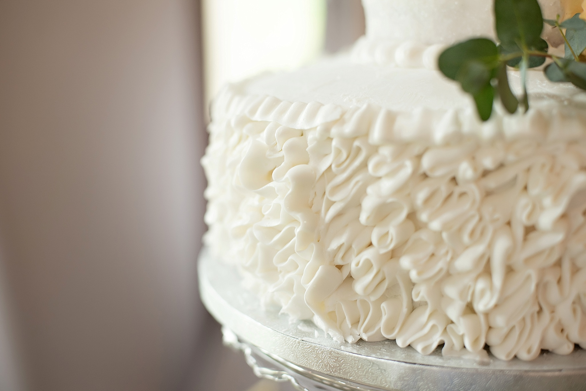 ruffle frosting on white wedding cake