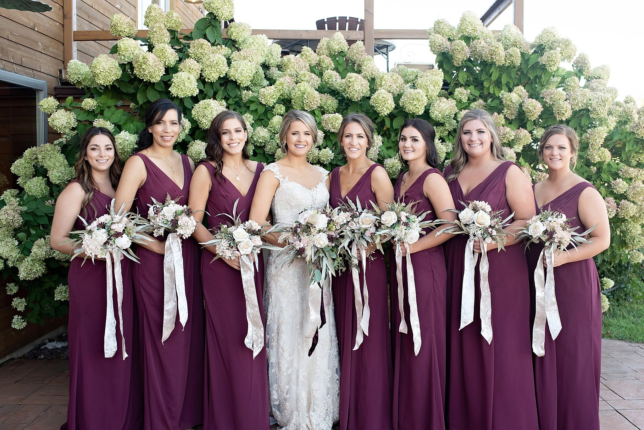 burgundy matching bridesmaid dresses with blush florals