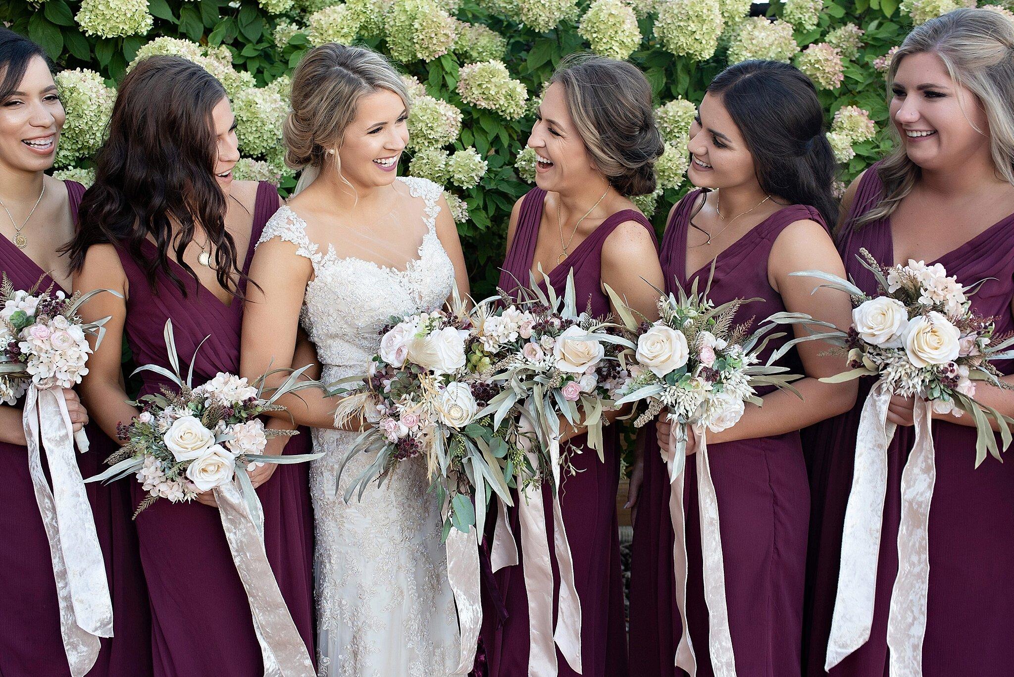 burgundy sleeveless bridesmaid dress flowy lace wedding gown