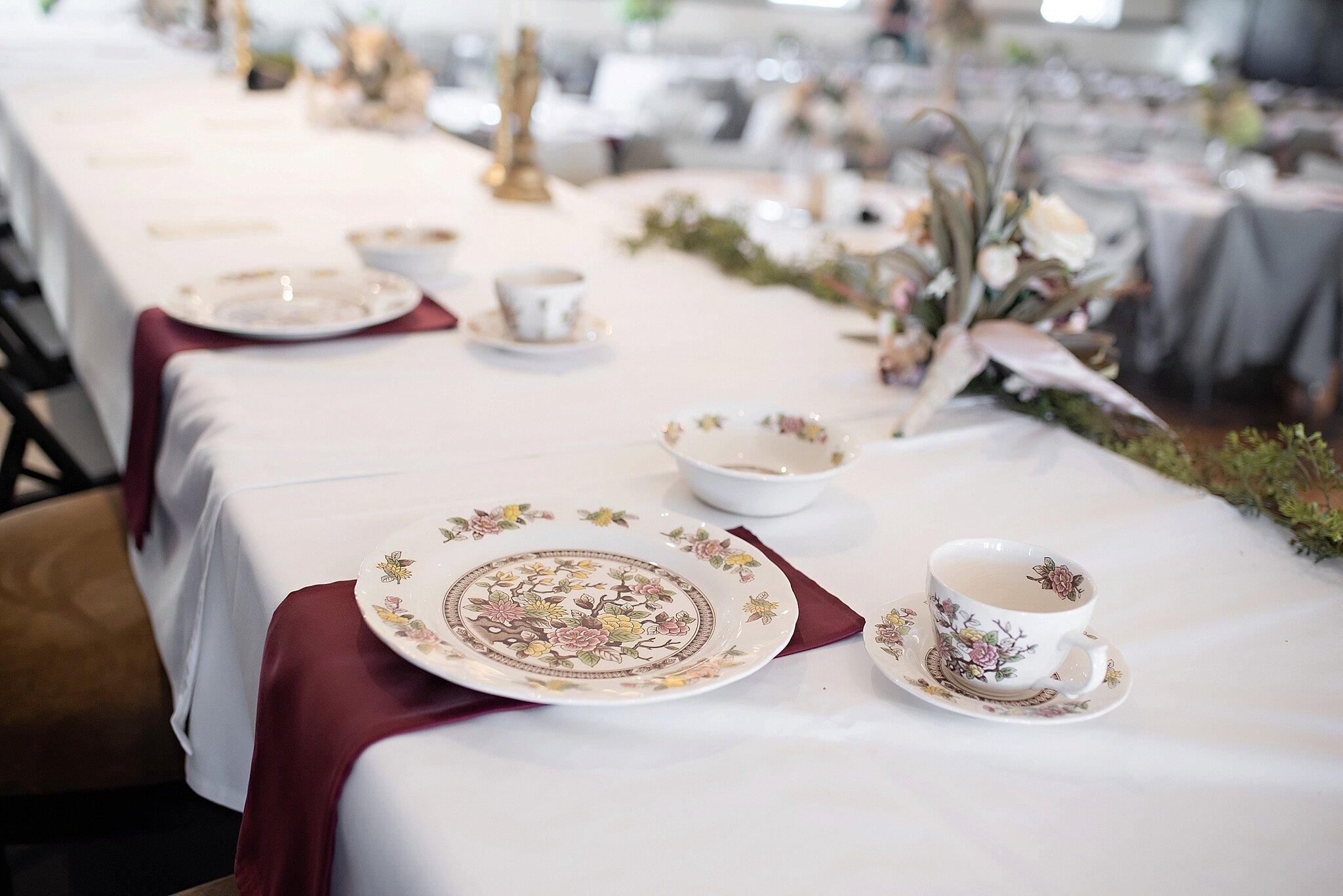 vintage china at the head table vineyard wedding