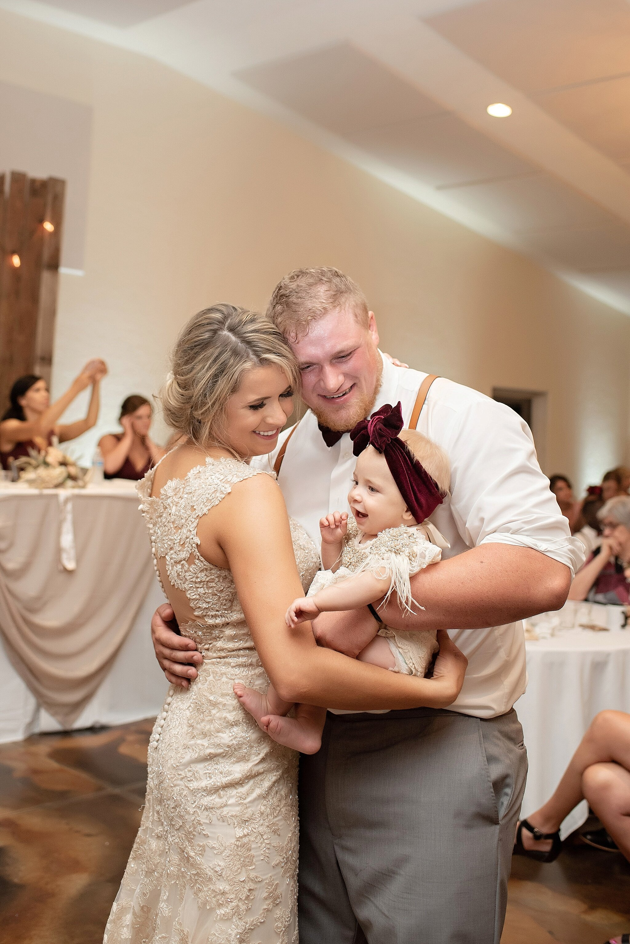 family of three at wedding dance