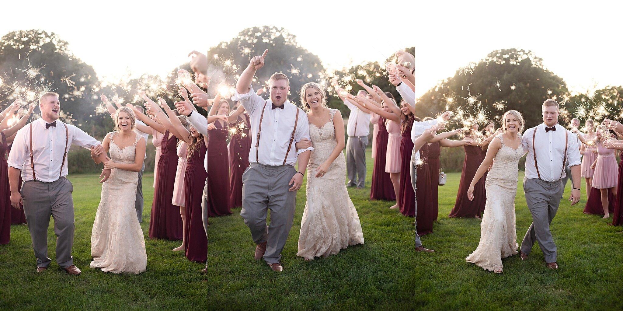 wedding party sparkler exit kate jones studios sioux falls wedding photographer