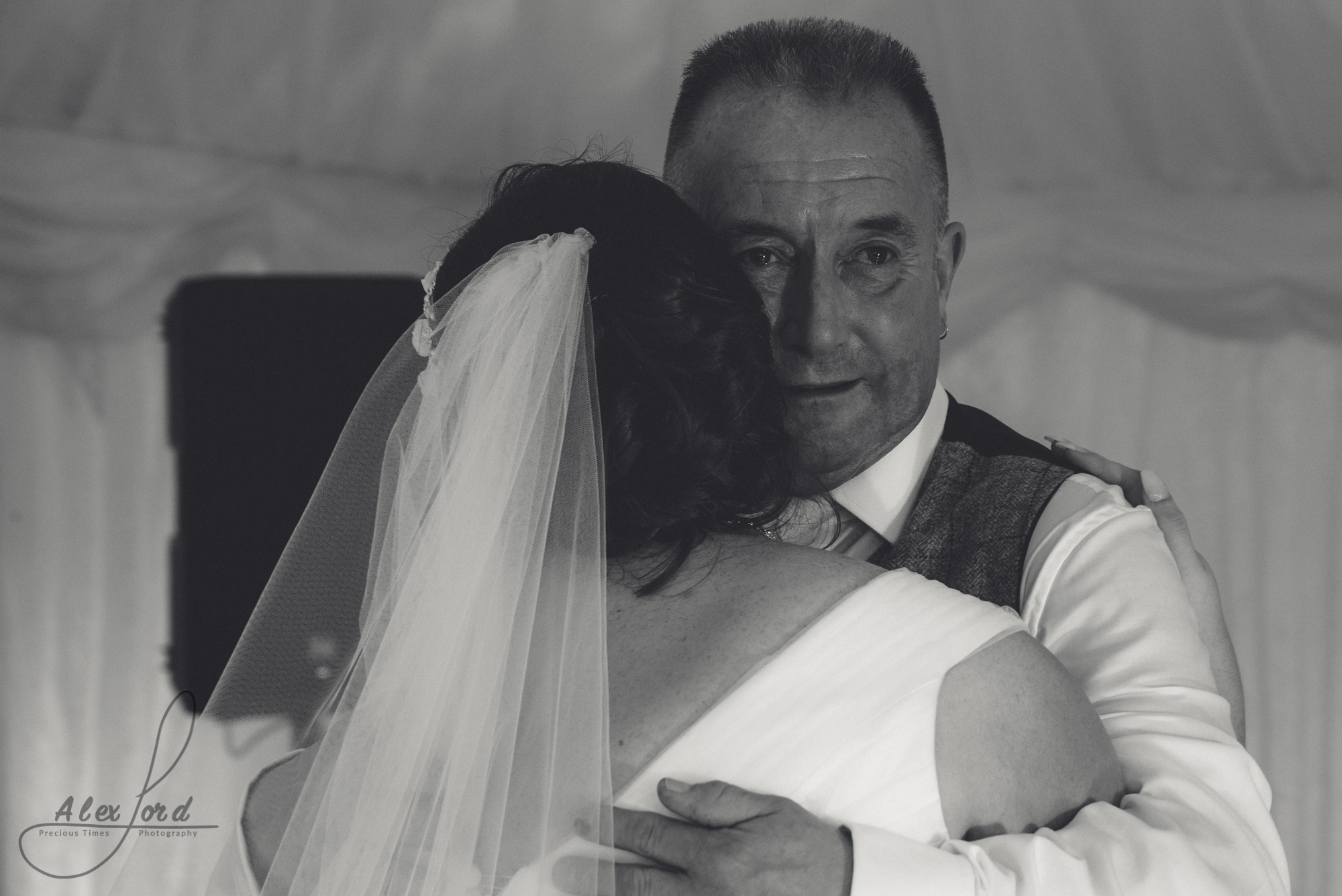 The bride shares a dance with her emotional dad.