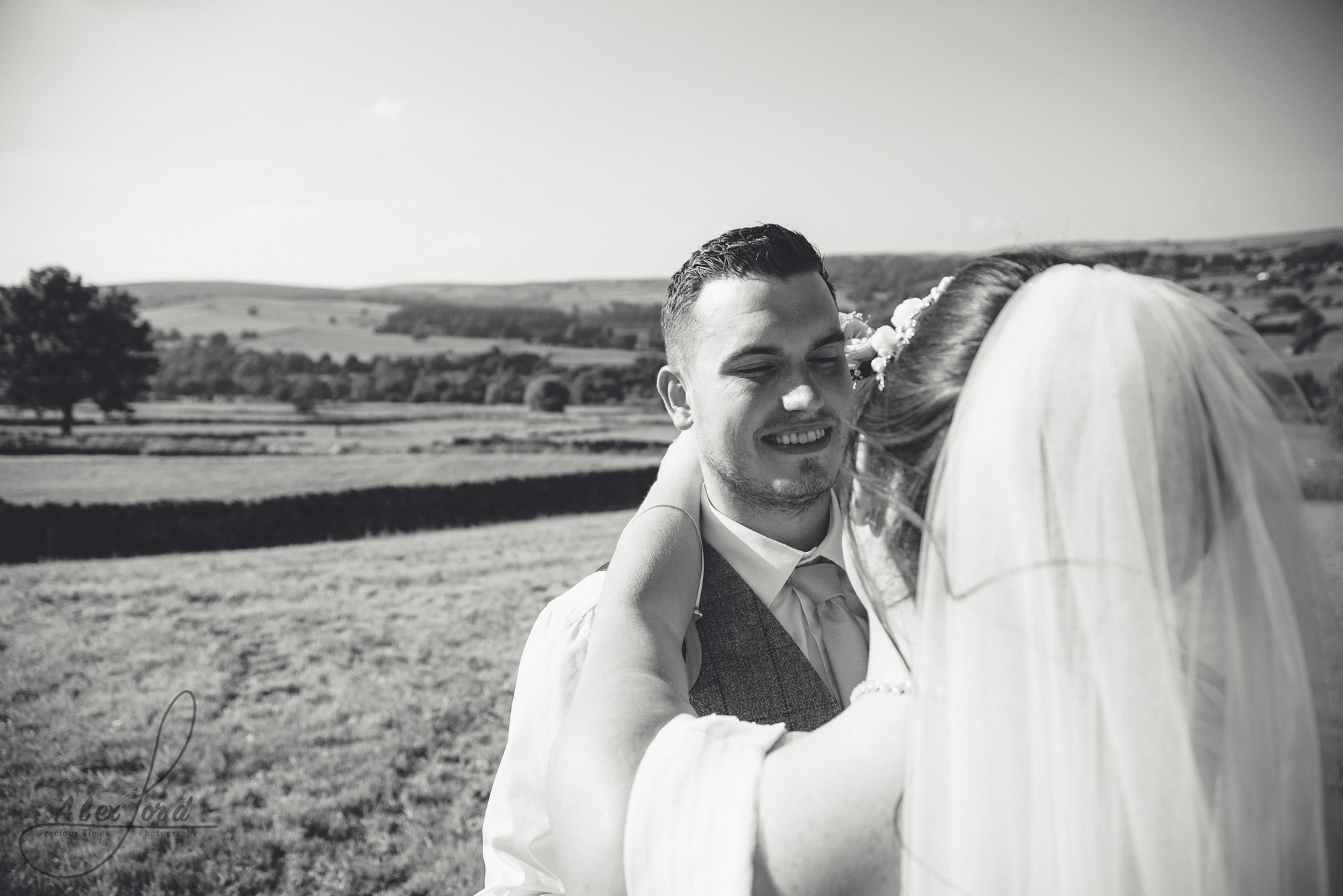 Black and white image of the groom looking into the brides eyes