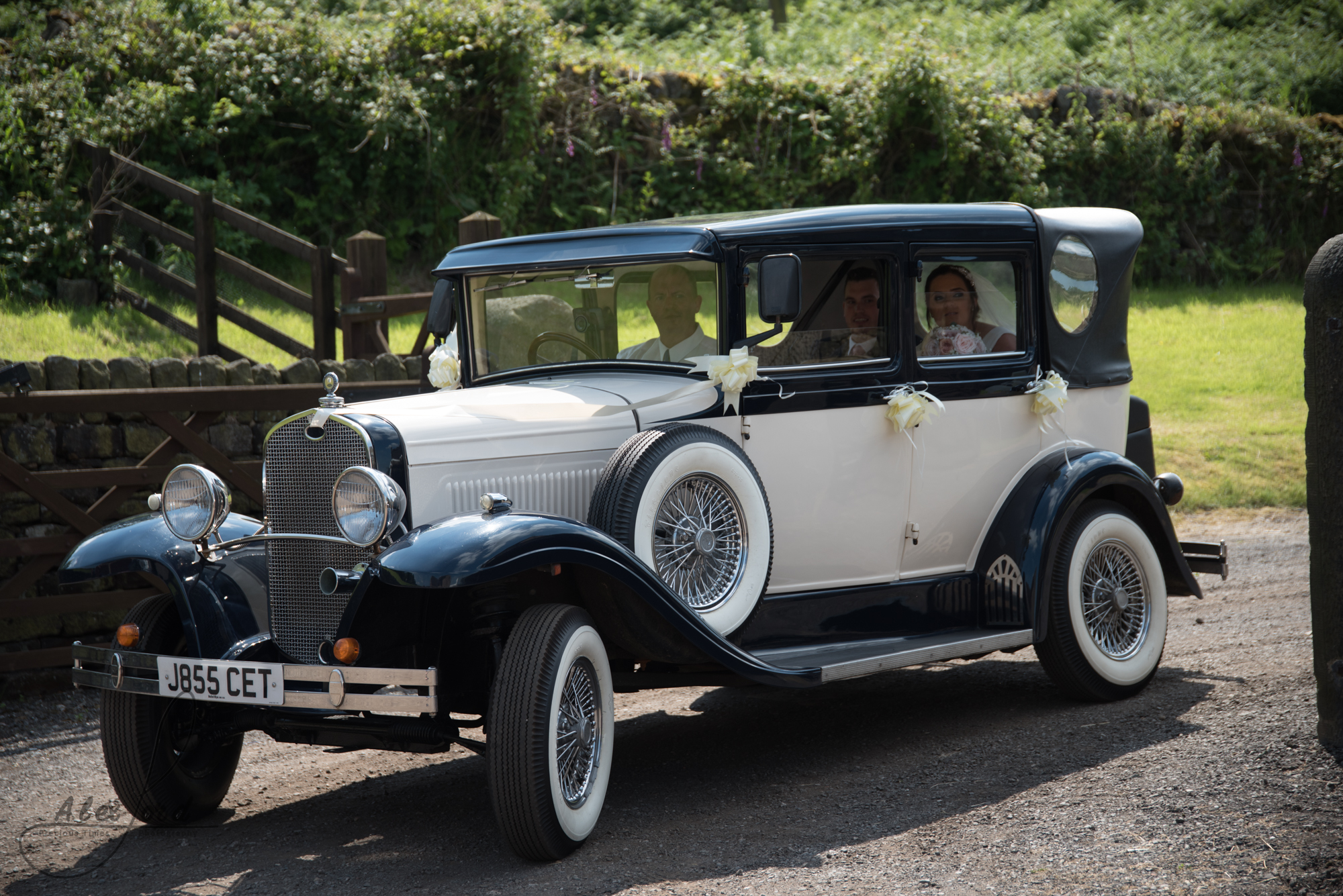 The car arrives at Swancar farm with the bride and groom
