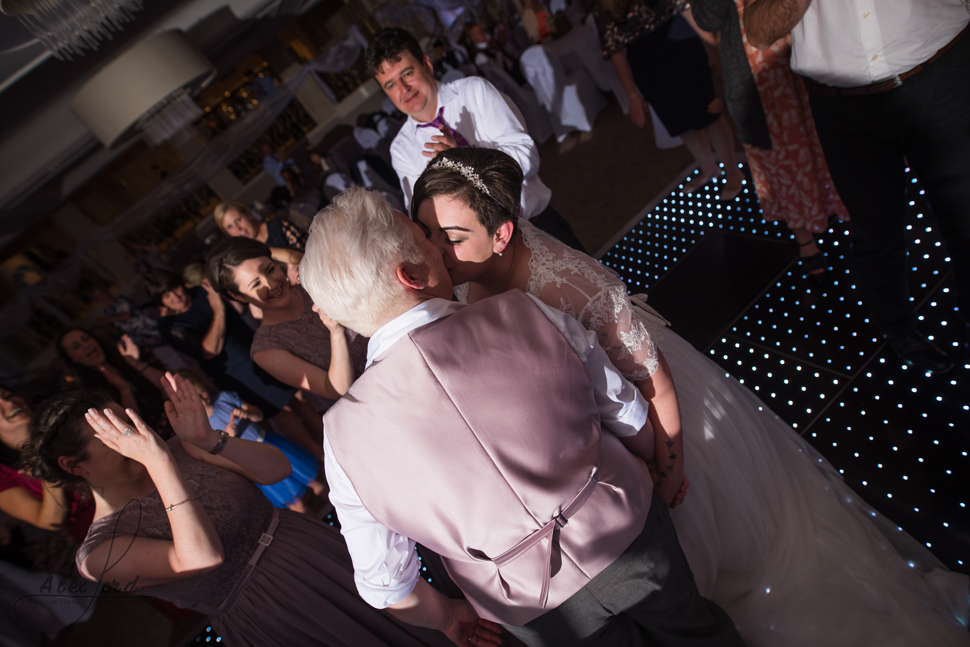 the bride and bride have their first dance together