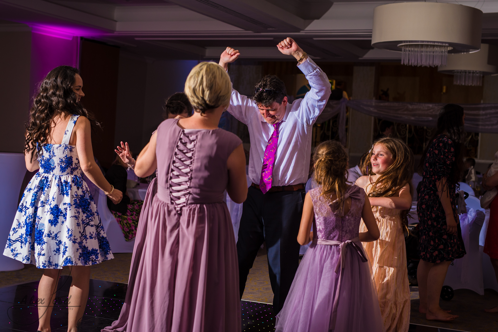 wedding guests dance their legs off on the dance floor before the bride and bride have their first dance