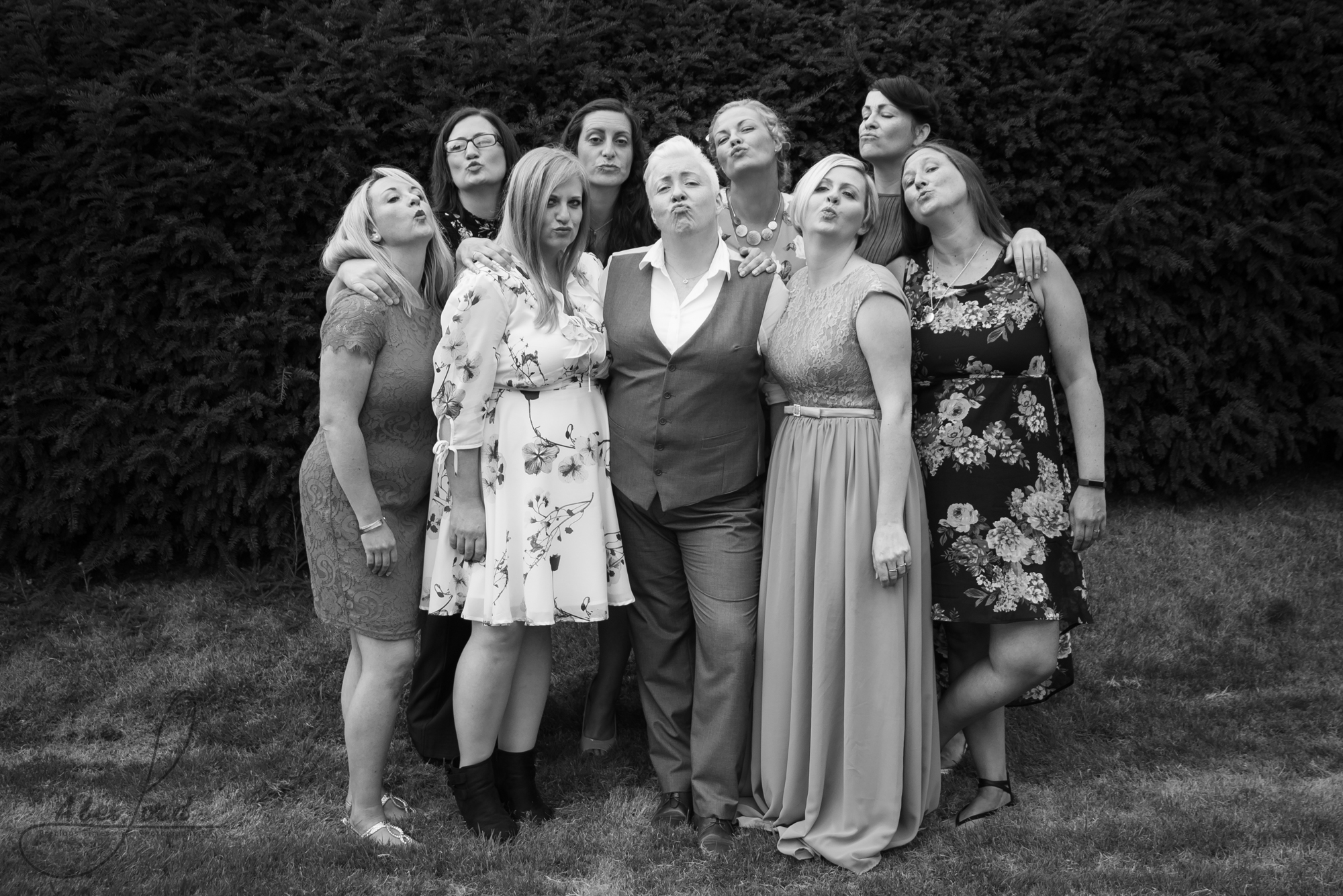 some of the brides family gather outside for a late night family group photograph