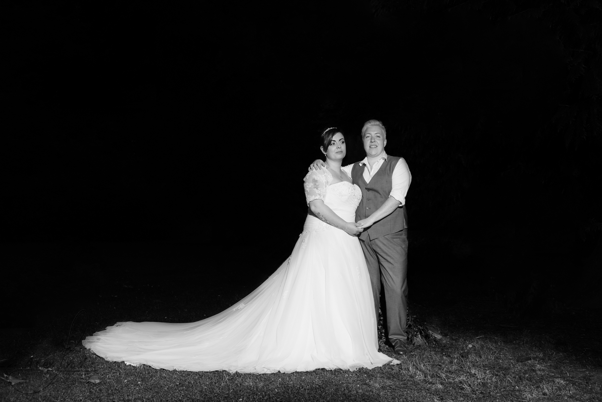 the bride and bride go outside for their wedding photography in the dark
