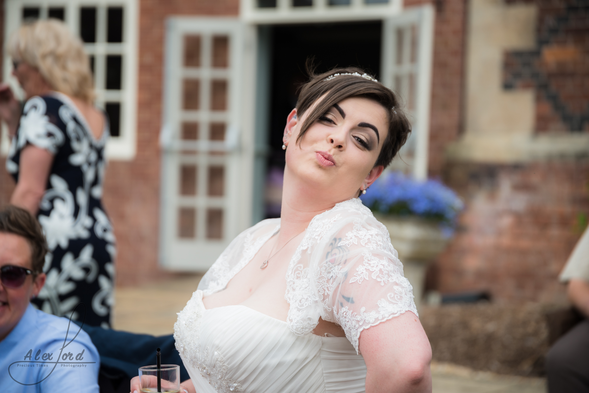 the bride puts directly at the camera outside the wedding venue