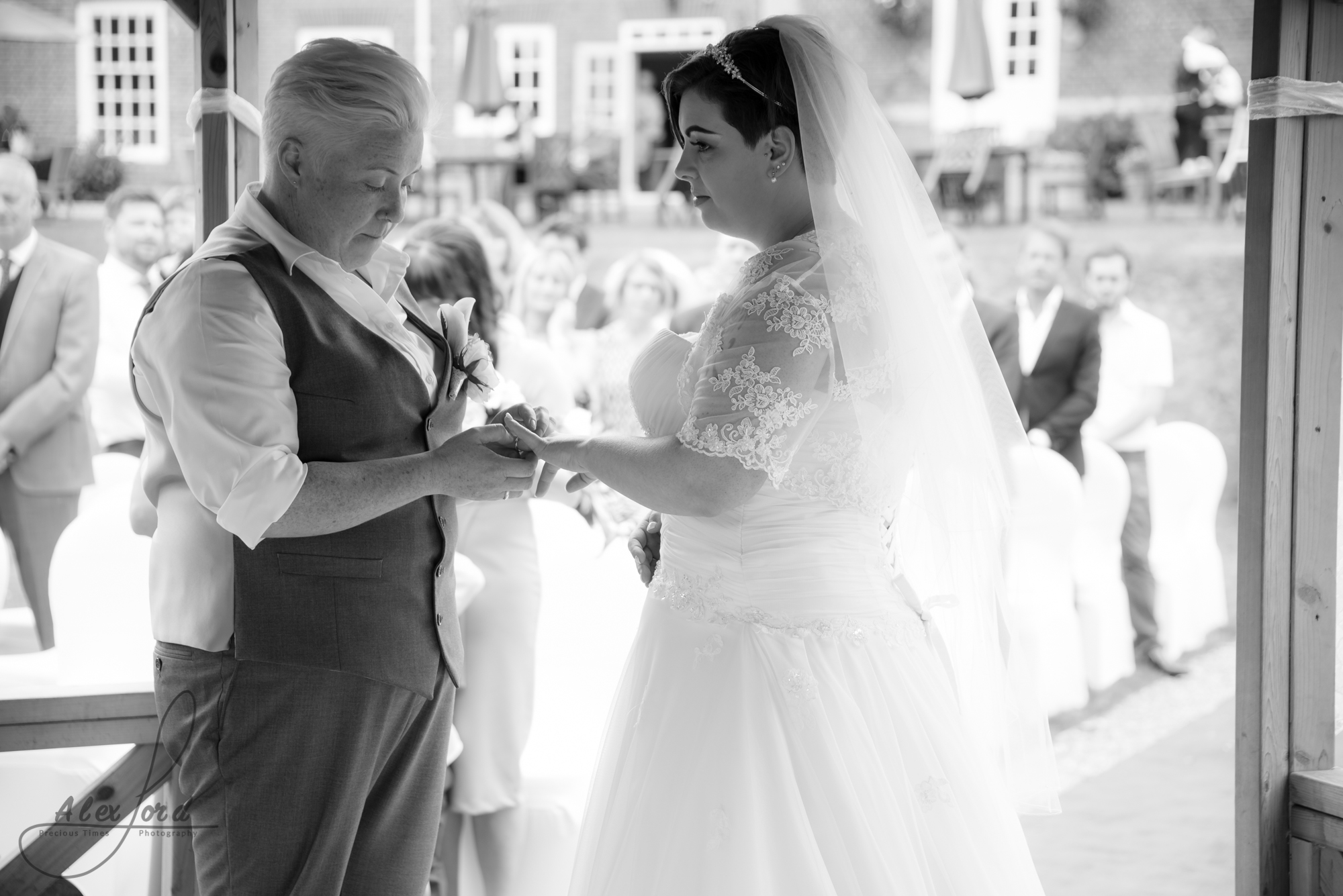 the bride and bride say their vows outside their shropshire wedding venue