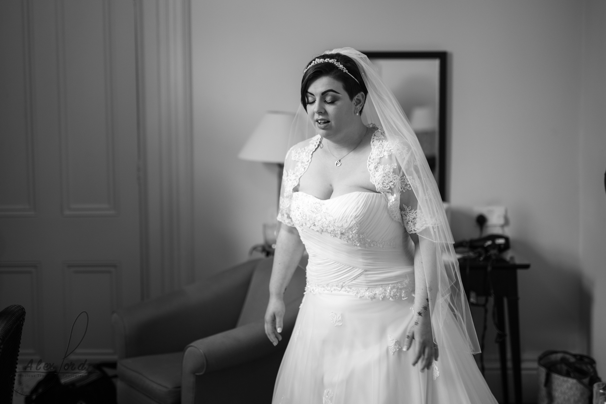 the bride all ready for the wedding ceremony, wearing a lace princess dress
