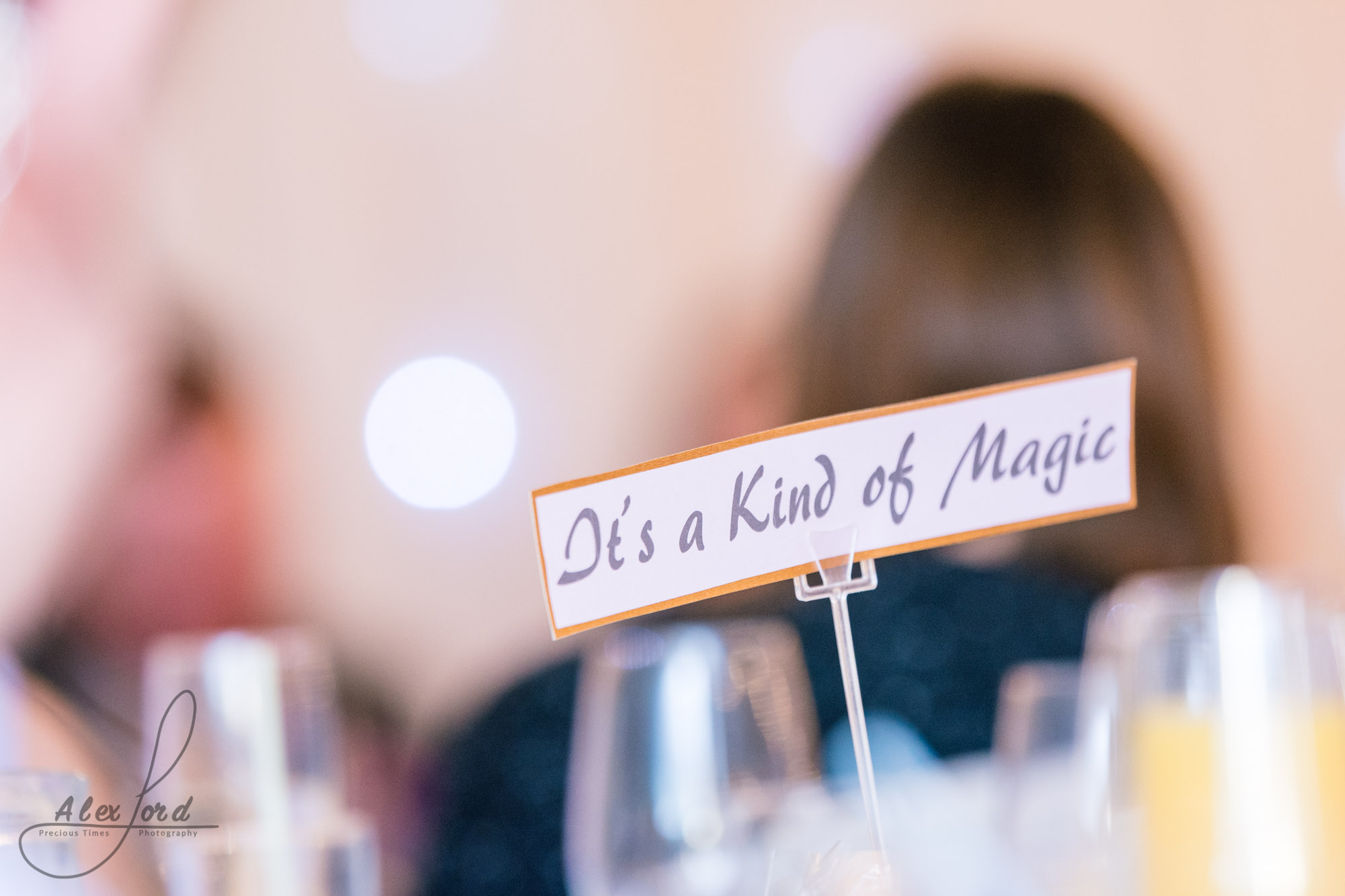 an outline of a wedding guest behind one of the wedding breakfast table names