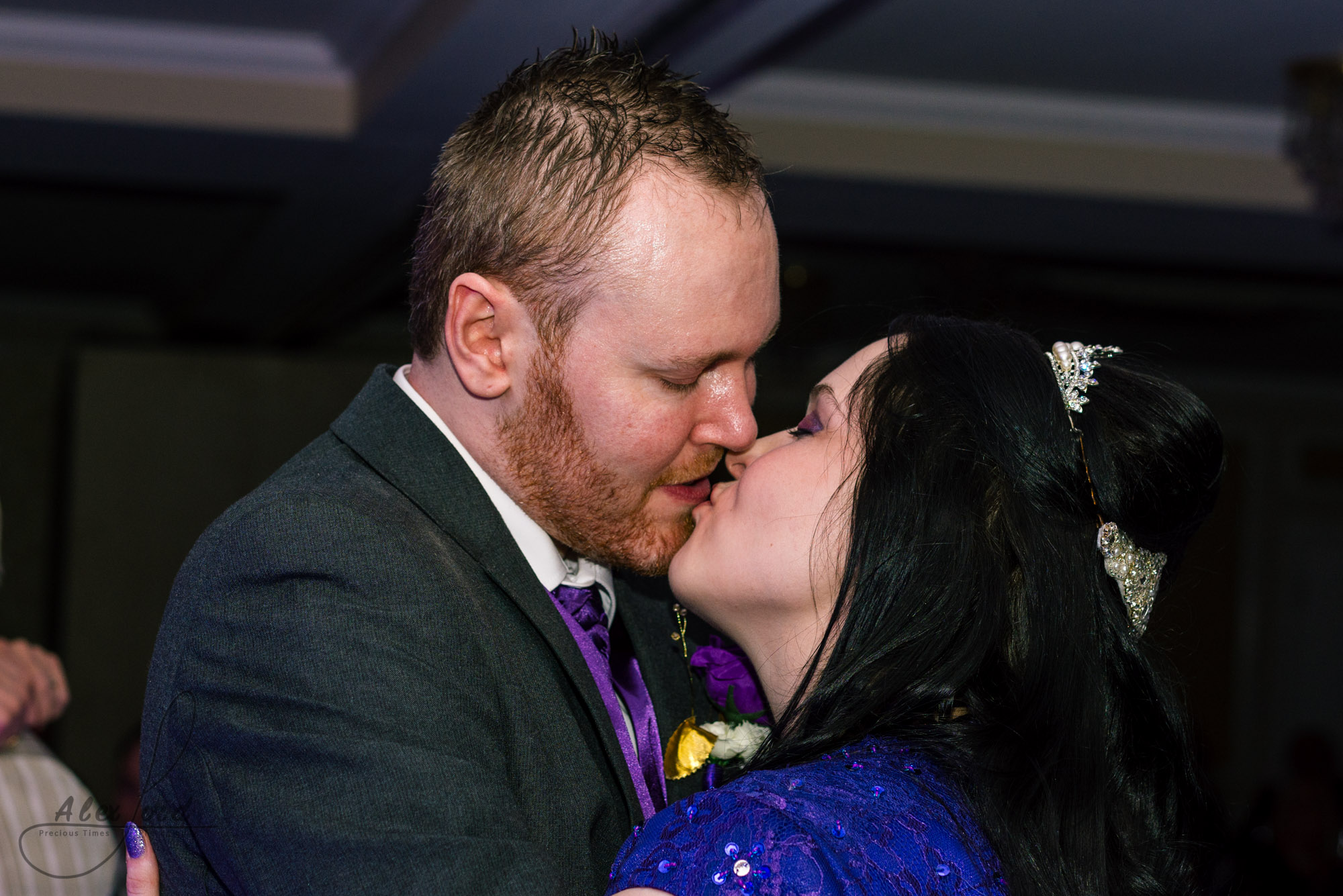 the bride and groom have a kiss during their first dance