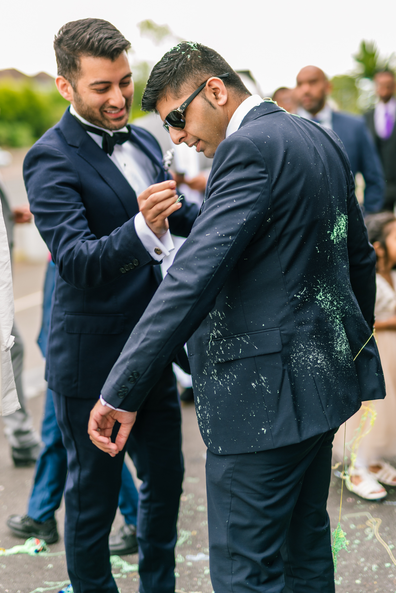 The grooms party make final checks to their suits before they enter the wedding venue