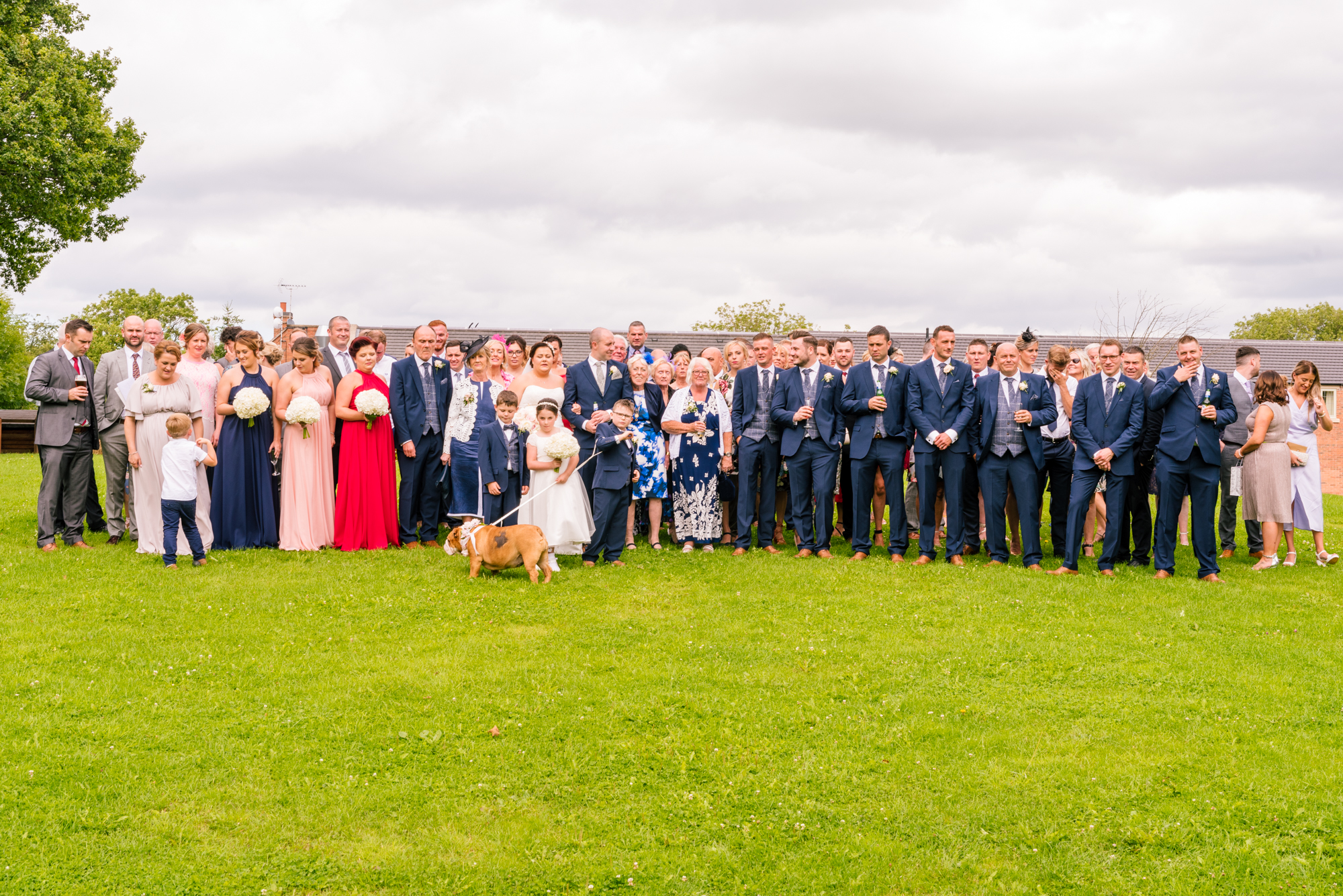 all the guests gather for a full group photo