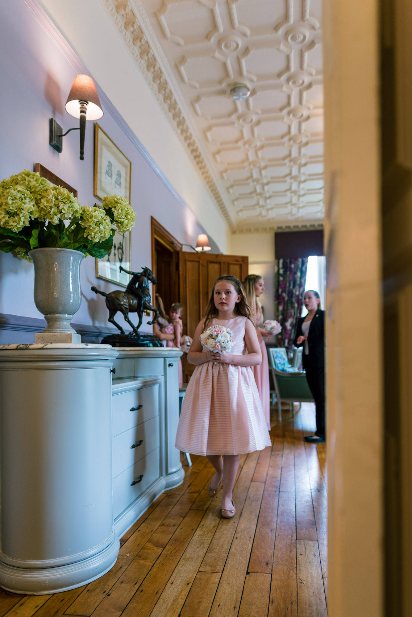 Flower girl walks into the wedding ceremony