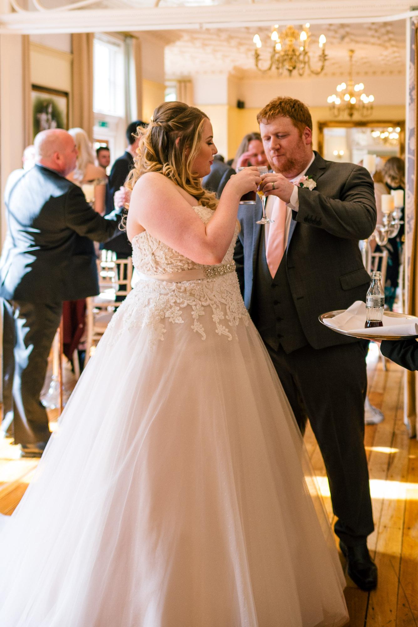 Bride and groom enjoy a drink together