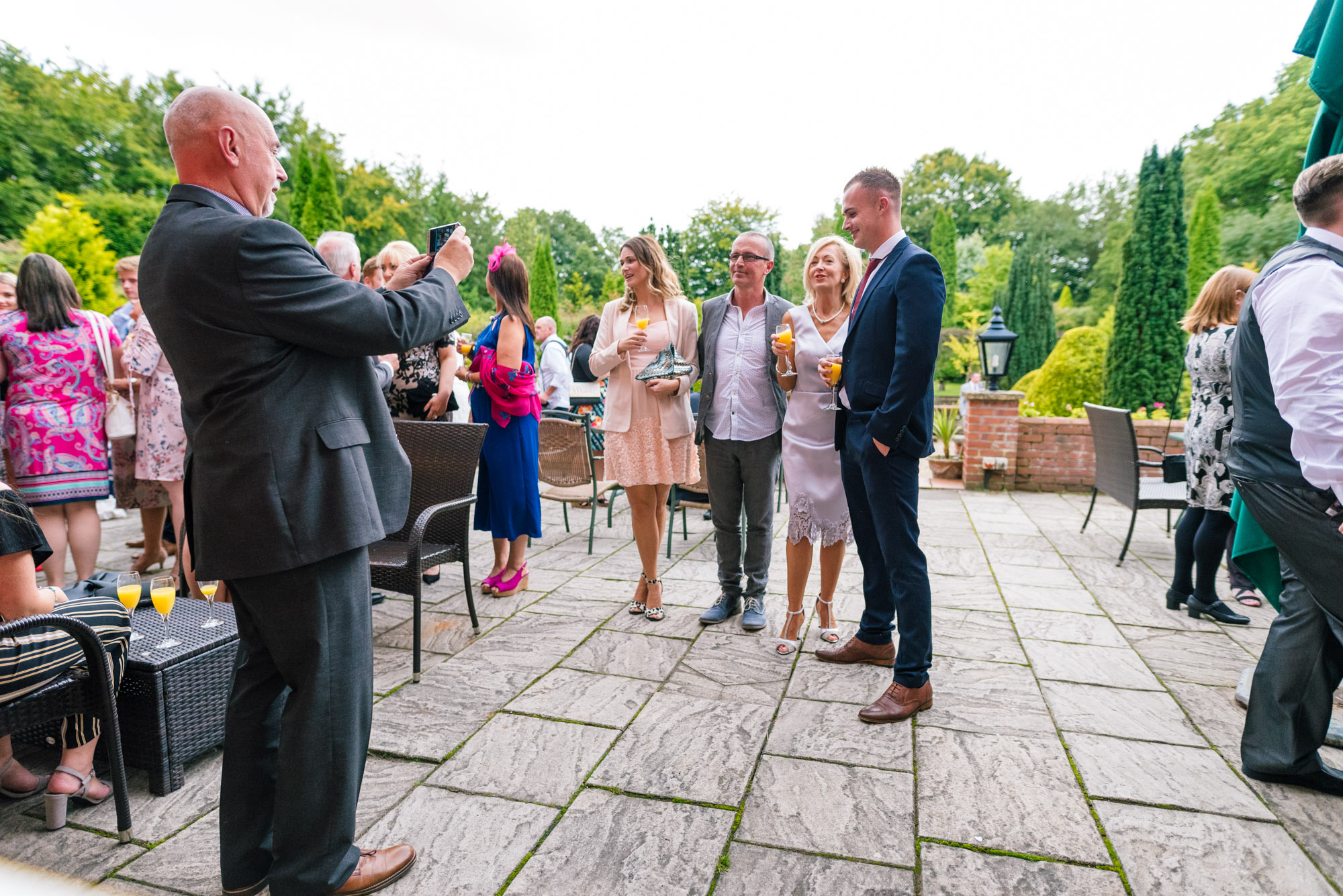 Guests take selfies outside nunsmere hall