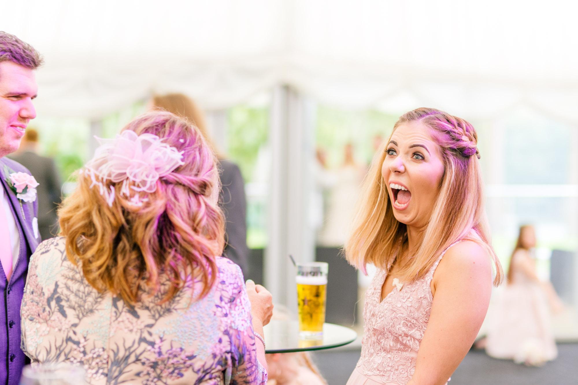 Wedding guest having a laugh