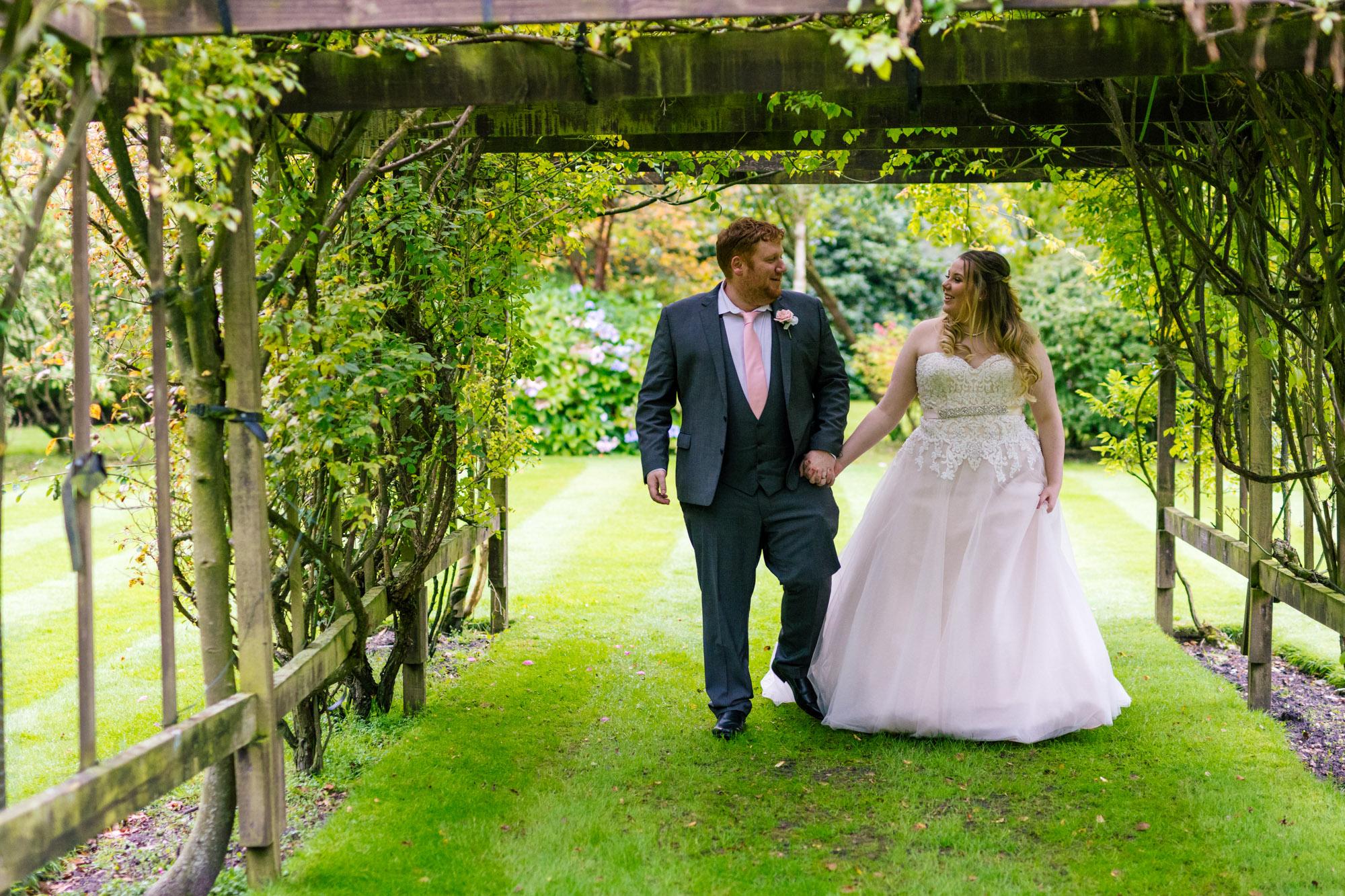 bride and groom enjoying nunsmere hall together