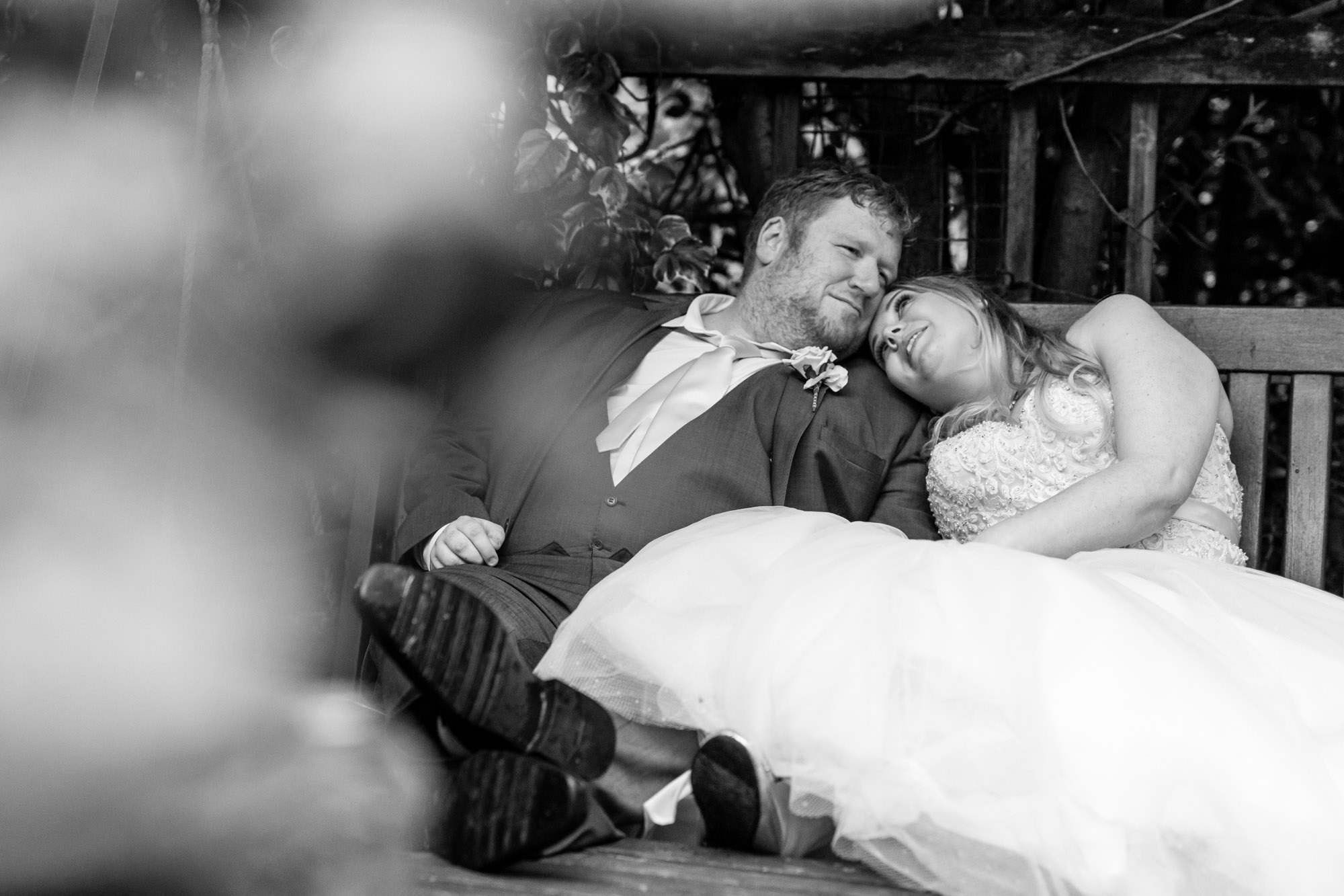 bride and groom having a cuddle